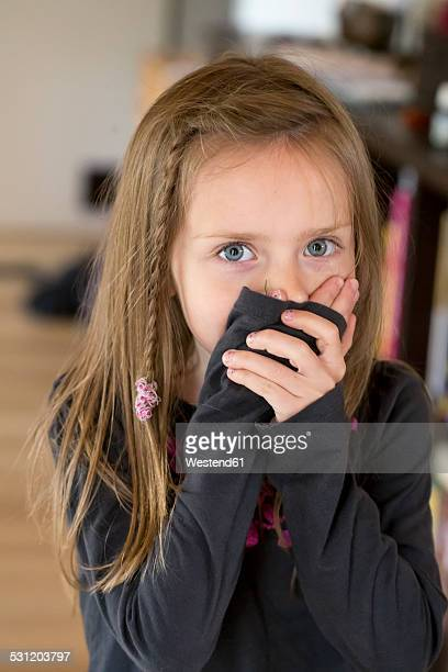 Girl covering mouth with her hands