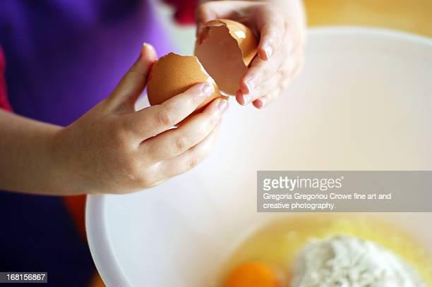 girl cracking an egg - gregoria gregoriou crowe fine art and creative photography. fotografías e imágenes de stock
