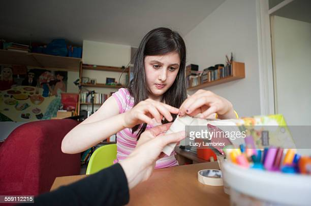 Girl crafting a horse from waste materials