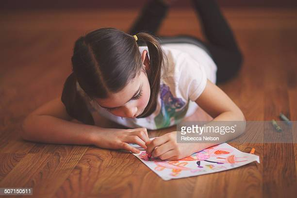 girl creating crayon drawing - rebecca nelson stock pictures, royalty-free photos & images