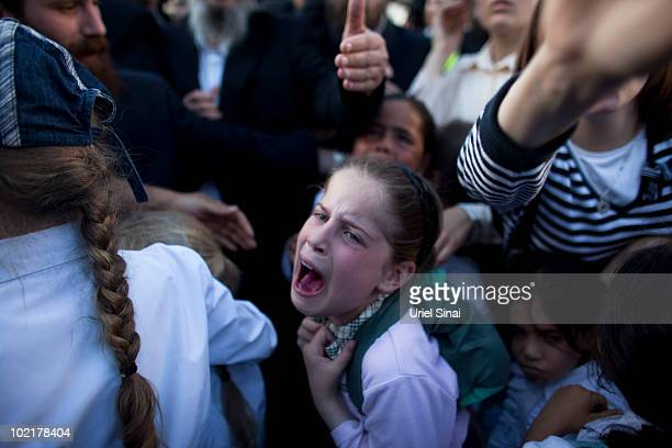 A girl cries after her father was taken to jail as UltraOrthodox Jews attend a rally June 17 2010 in Jerusalem Israel Tens of thousands of religious...
