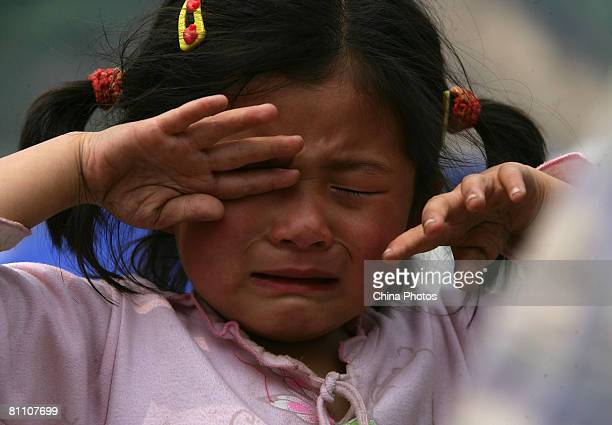 A girl cries at the Zipingpu Dam May 16 2008 between Wenchuan and Dujiangyan Sichuan Province China A major earthquake measuring 79 on the Richter...