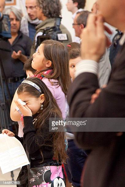 Girl cries during a mass celebrated in the Cathedral on May 20 2012 following a blast that killed 16-year-old Melissa Bassi. No one has claimed...