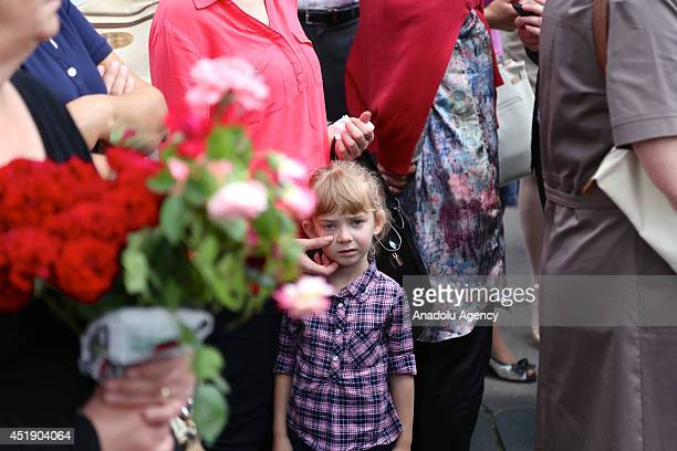 A girl cries during funeral of 175 Srebrenicans massacred by Serbian troops on July 111995 depart from Visoko to Potocari on July 9 2014 in Sarajevo...
