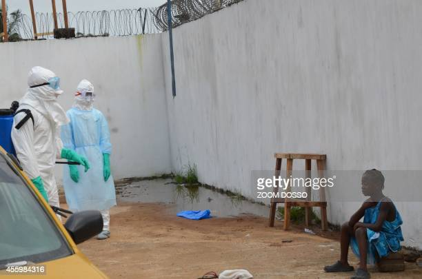 A girl cries outside the Island Clinic a new Ebola treatment centre that opened in Monrovia after the death of her father and her mother by ebola on...