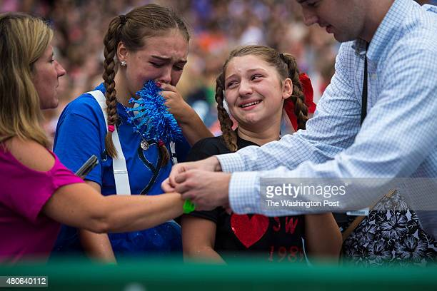 A girl cries while moving closer to the stage before Taylor Swift preforms a concert at the Washington Nationals Stadium in Washington DC on Monday...
