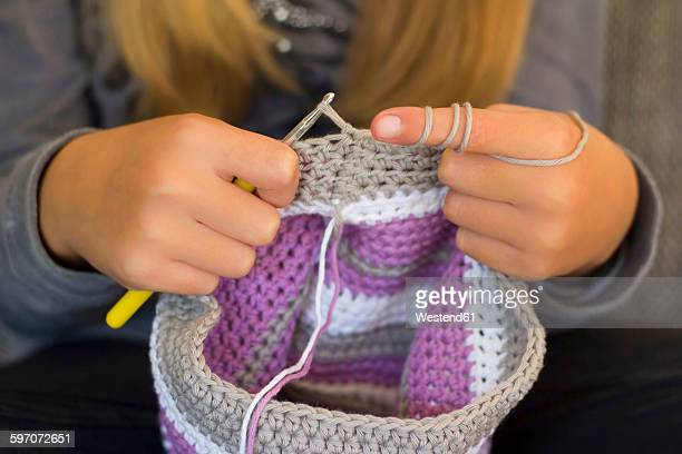 girl crocheting a cap, close-up - crochet stock pictures, royalty-free photos & images