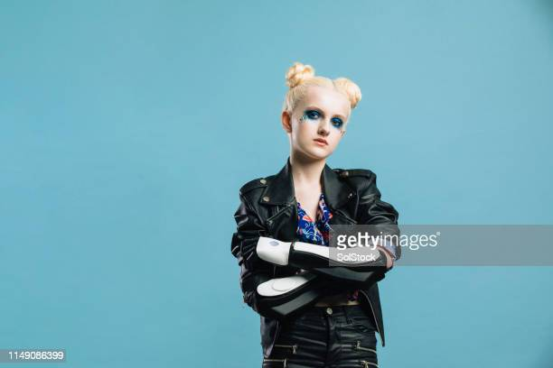 girl crosses her robotic arms - amputee girl stock pictures, royalty-free photos & images