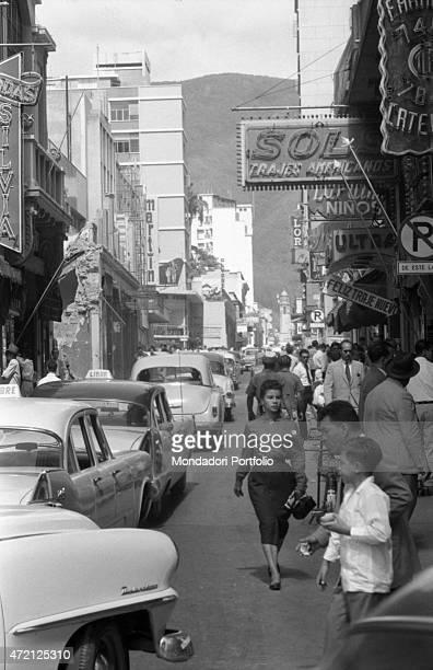 'A girl crossing a street of the city Caracas January 1958 '