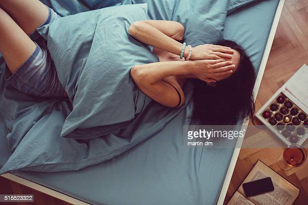 Girl crying in bed