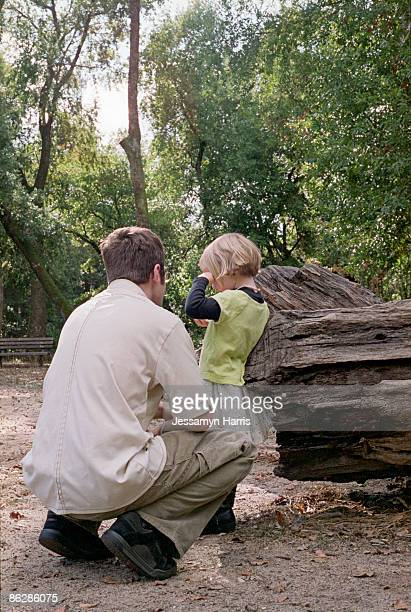 Girl crying in the forest with father