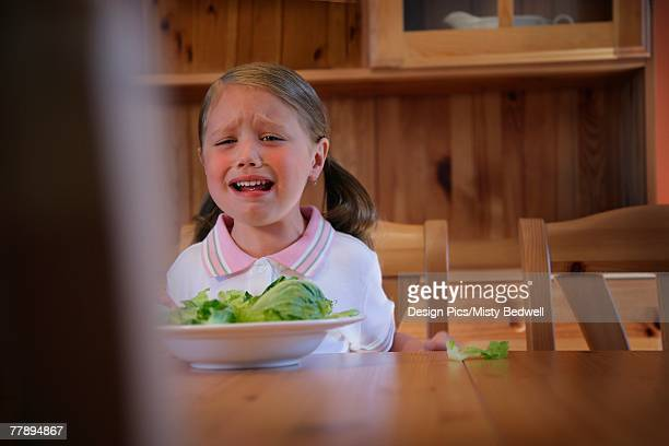 Girl crying over dinner