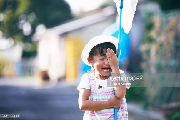 Girl crying with butterfly net