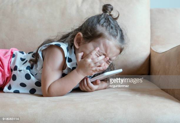 Girl crying with tablet