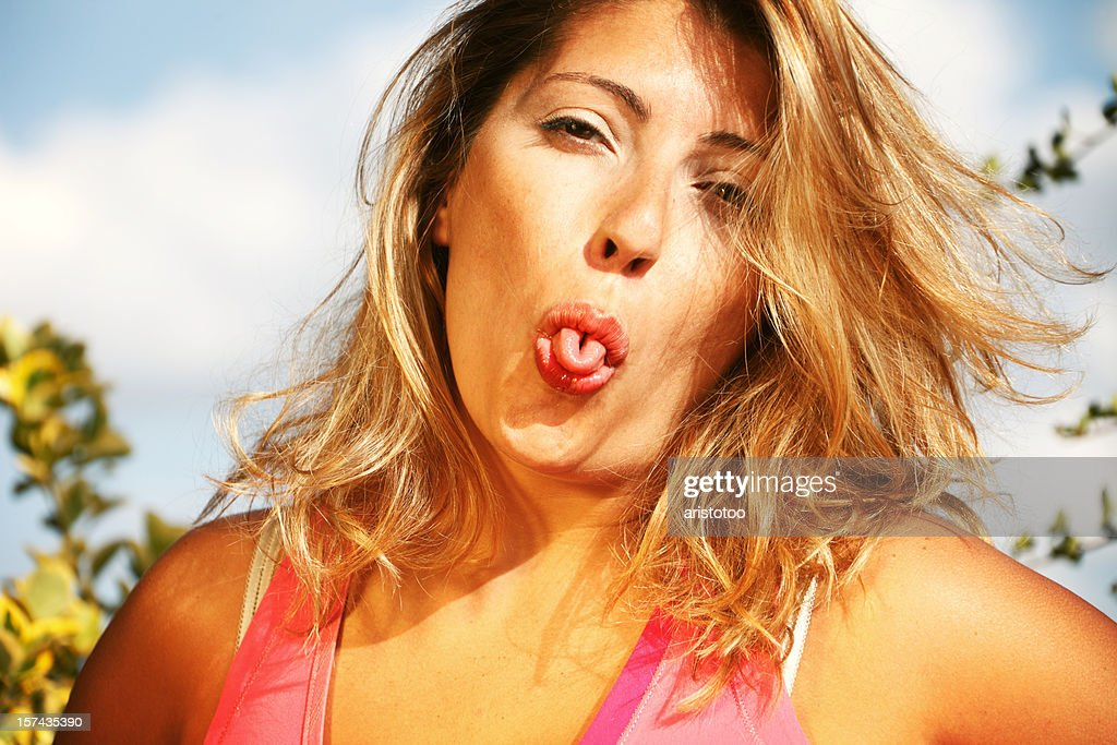 Girl Curling Tongue : Stock Photo