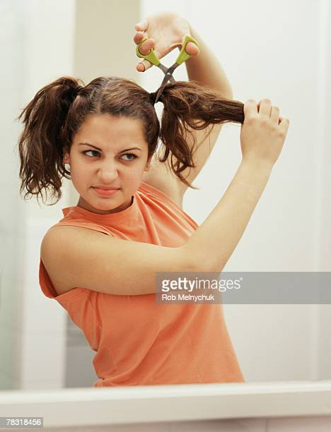 Girl cutting hair
