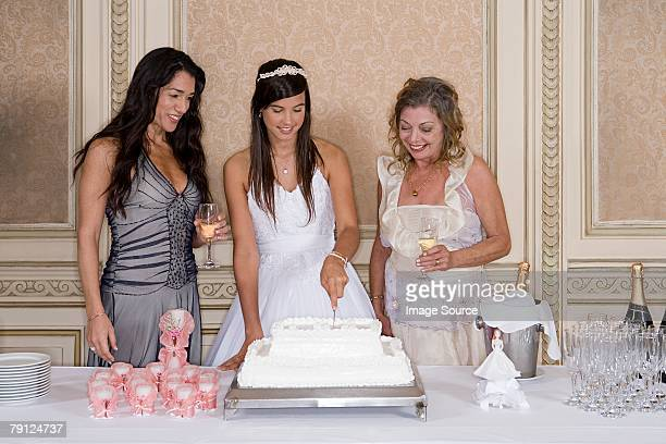 Girl cutting quinceanera cake
