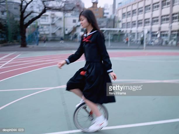 Girl  cycling at the stadium