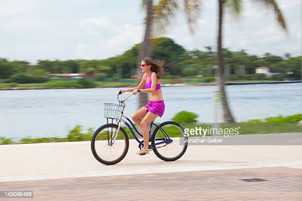 Girl cycling barefoot