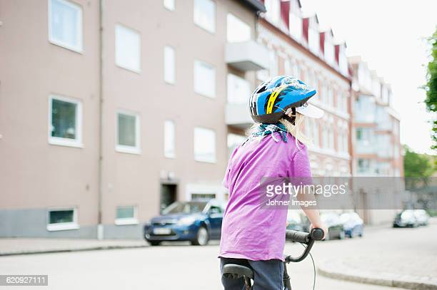 Girl cycling in street