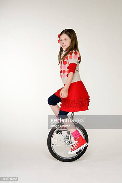 A girl cycling on a unicycle