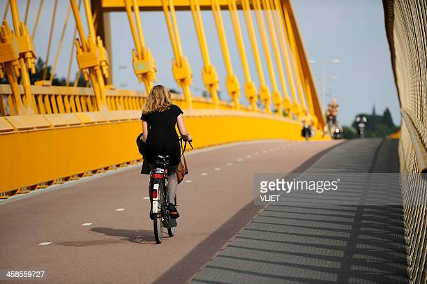 girl cycling on hogeweidebrug in utrecht - utrecht stockfoto's en -beelden