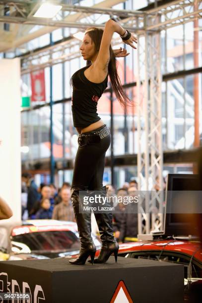 A girl dances at an exhibition stand during the Bologna Motor Show 2009 on December 6 2009 in Bologna Italy