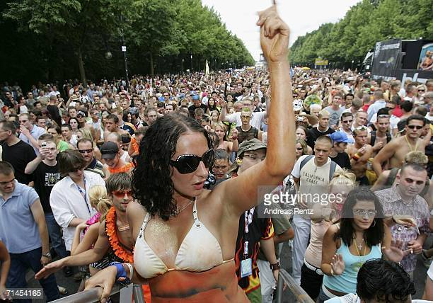 A girl dances during the 16th annual Loveparade weekend July 15 2006 in Berlin Germany Over 300 DJs on 39 trucks so called 'floats' turn the street...