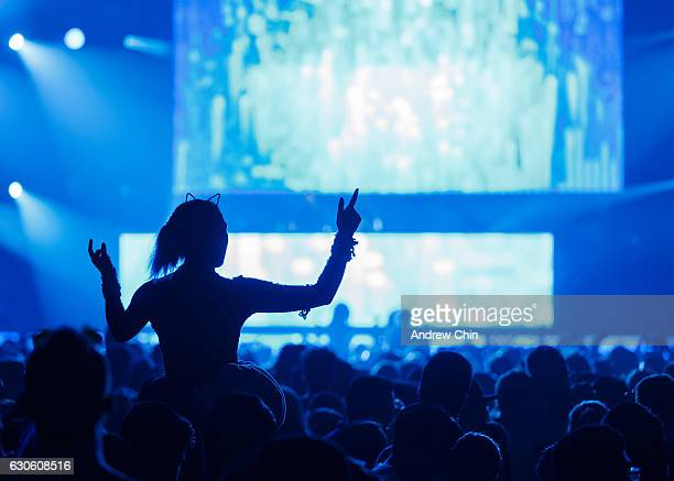 A girl dances on a shoulder ride during day 2 of Contact Winter Music Festival 2016 at BC Place on December 27 2016 in Vancouver Canada
