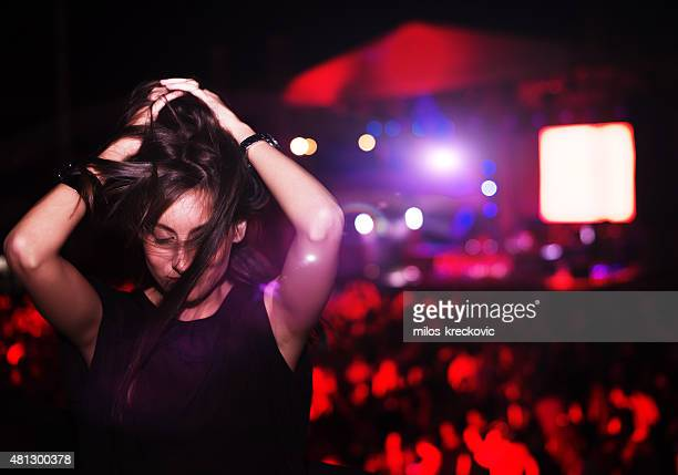 Girl dancing at concert