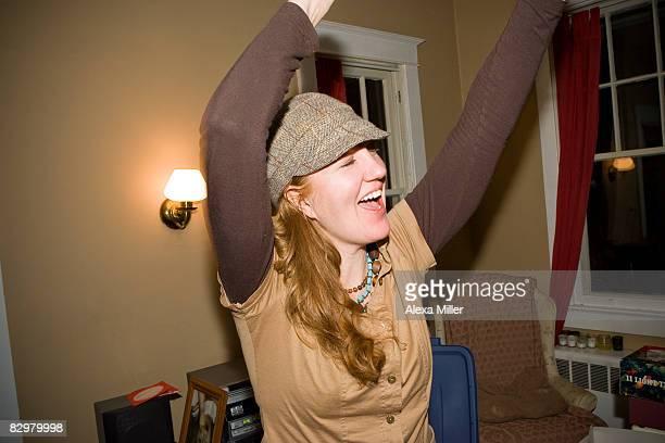 Girl dancing at home.