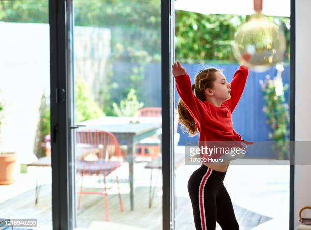 girl dancing at home with arms out - one girl only stock pictures, royalty-free photos & images
