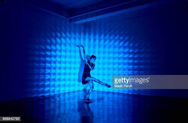 girl dancing in a studio with graphic patterns projected onto her - performing arts event stock pictures, royalty-free photos & images