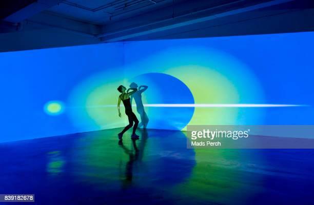 girl dancing in abstract space - passione foto e immagini stock