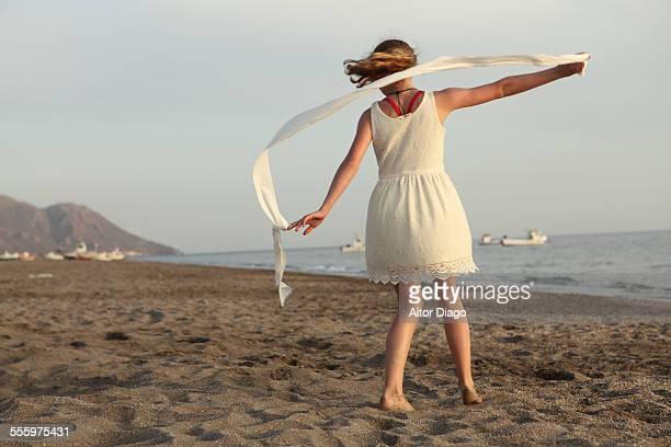 Girl dancing in the beach.