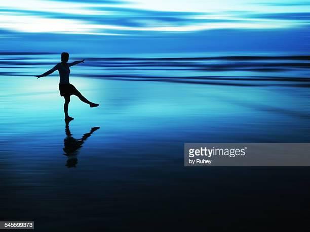 Girl dancing in the seashore