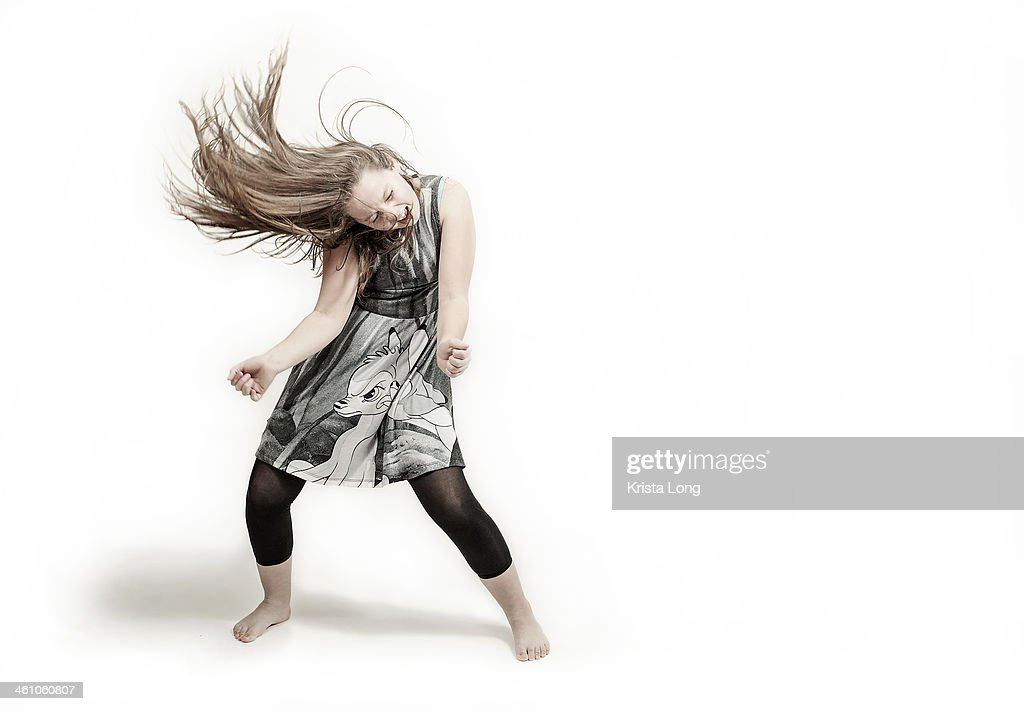 girl dancing on a plain white background : Stock Photo