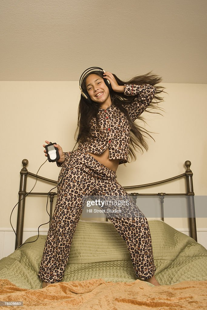 girl dancing on bed