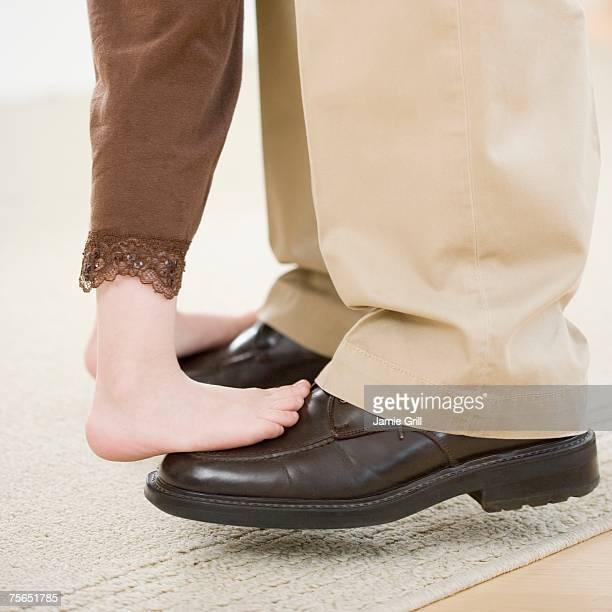 Girl dancing on father's feet