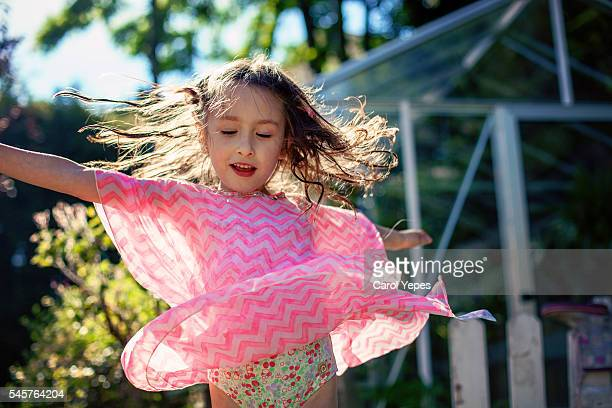 girl dancing outdoors - little girls up skirt stock pictures, royalty-free photos & images