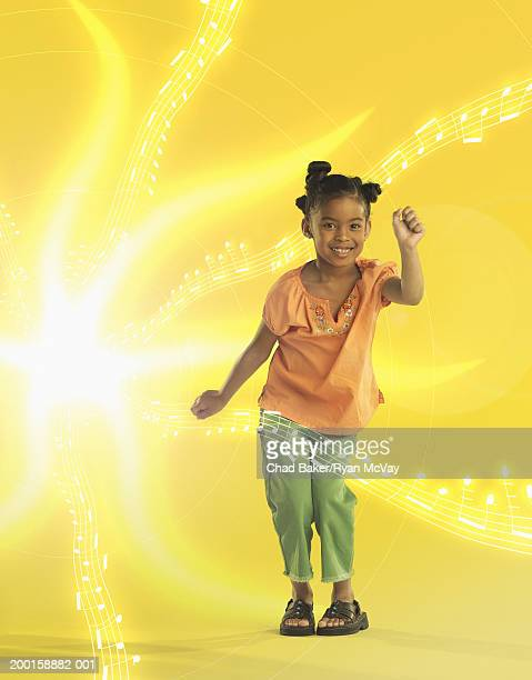 Girl (6-8) dancing, surrounded by musical notes (Digital Composite)