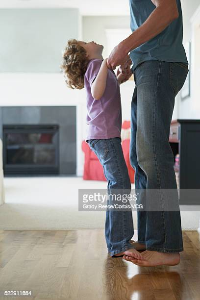 Girl dancing with father