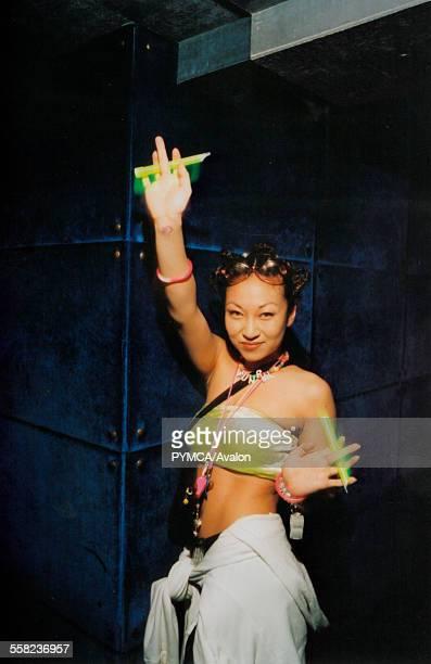 Girl dancing with glo sticks at Gatecrasher Mille Seoul Korea 2000
