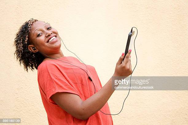A girl dancing with her smart phone
