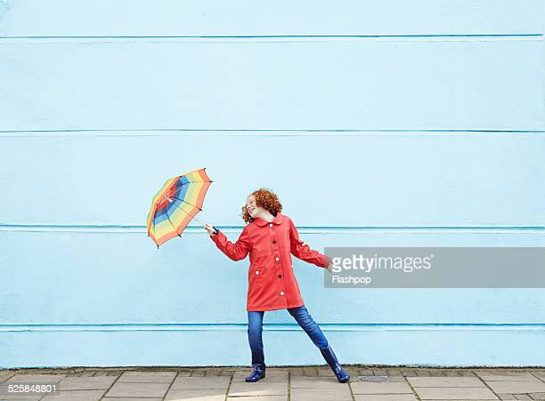 girl dancing with umbrella - motivation stock pictures, royalty-free photos & images