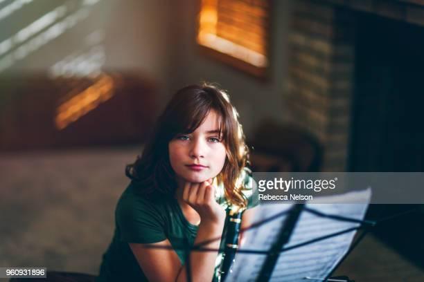 girl daydreaming at clarinet practice - clarinetto foto e immagini stock