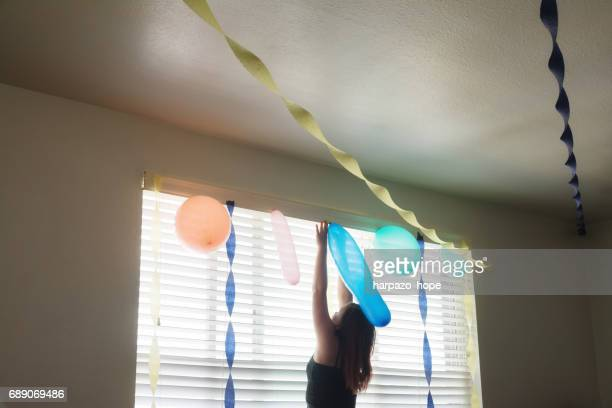 Girl Decorating for a Party