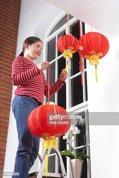 Girl decorating for Chinese New Year