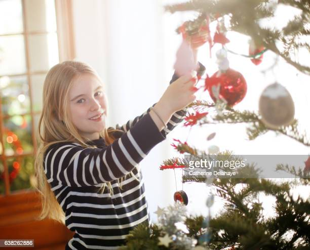 A girl decorating the Christmas tree