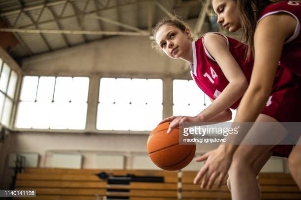 girl defending ball from opponent during match - dribbling sports stock pictures, royalty-free photos & images